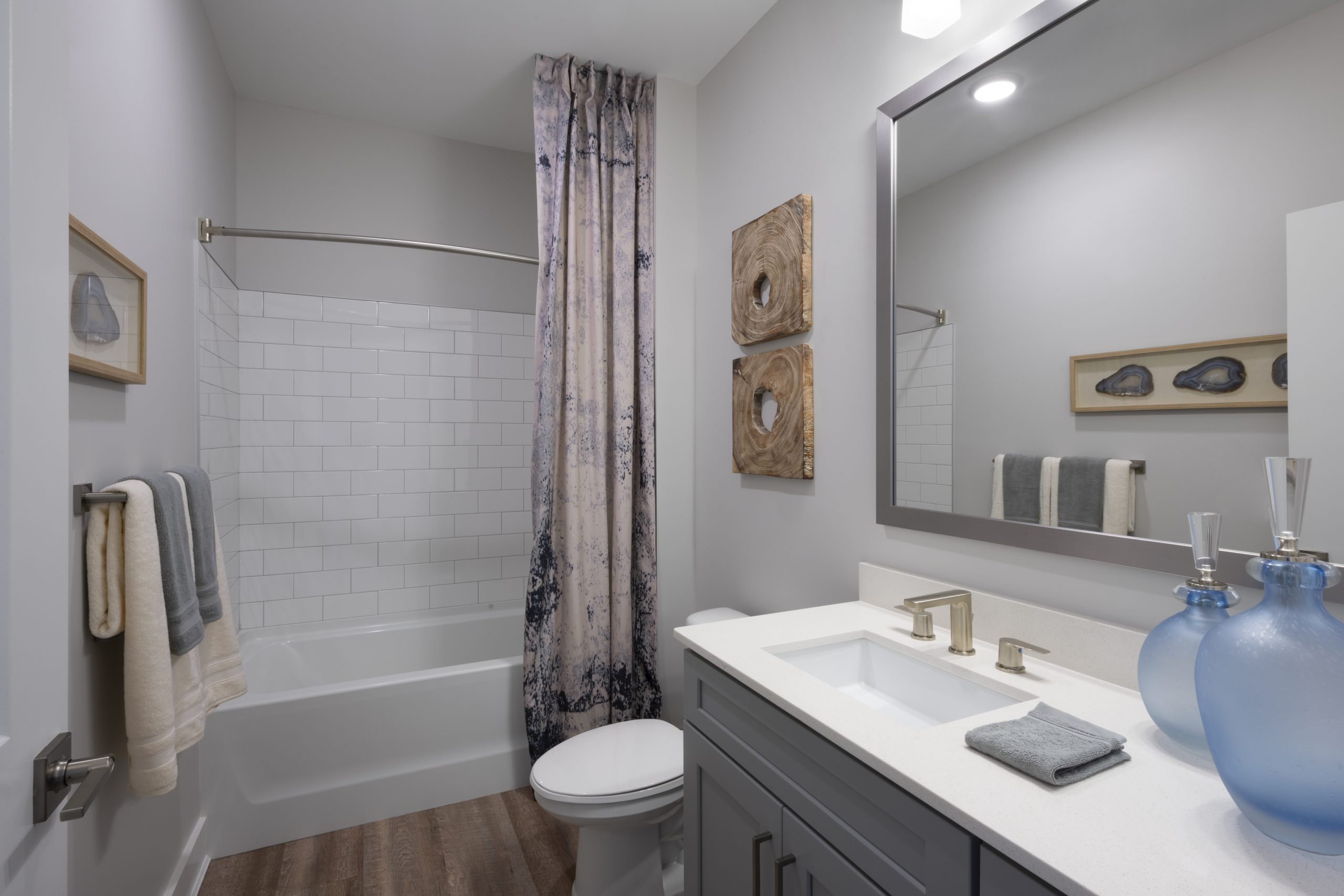 Curved shower bars and tons of floor space